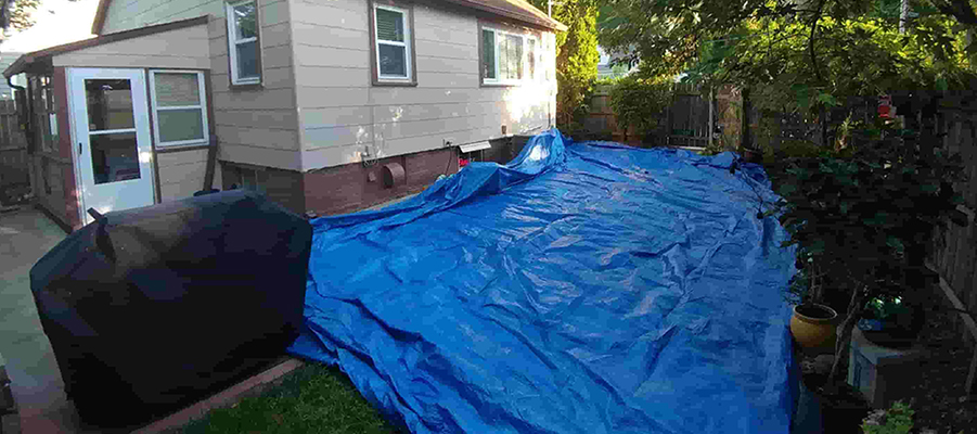 Tarping over lawn during roofing project